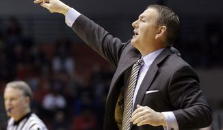 Central Florida head coach Donnie Jones directs his players in the first half of an NCAA college basketball game against Cincinnati, Thursday, Jan. 23, 2014, in Cincinnati. (AP Photo/Al Behrman)