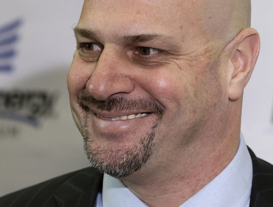 Cleveland Browns coach Mike Pettine smiles as he answers questions Thursday, Jan. 23, 2014, in Berea, Ohio. The 47-year-old Pettine, the son of a legendary Pennsylvania high school coach, spent one year with the Buffalo Bills after four as Rex Ryan's defensive coordinator with the New York Jets. (AP Photo/Tony Dejak)