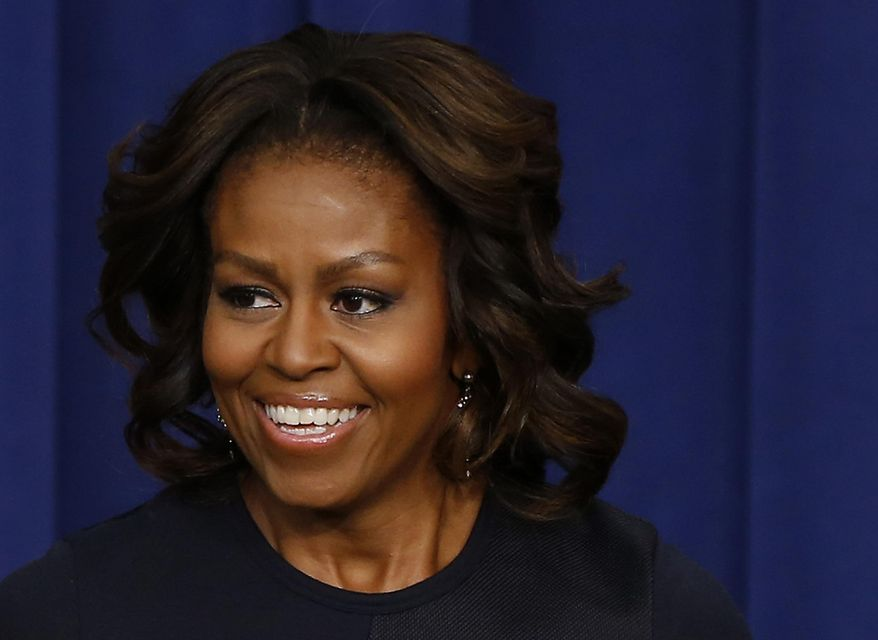 ** FILE ** This Jan. 16, 2014, file photo shows first lady Michelle Obama in the Eisenhower Executive Office Building on the White House complex in Washington. (AP Photo/Charles Dharapak, File)