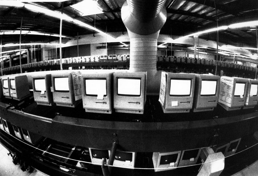 FILE - In this March 28, 1984, file photo, thousands of Apple Macintosh computers sit on double decked manufacturing lines. Friday, January 24, 2014, marks thirty years after the first Mac computer was introduced, sparking a revolution in computing and in publishing as people began creating fancy newsletters, brochures and other publications from their desktops. (AP Photo/Paul Sakuma, File)
