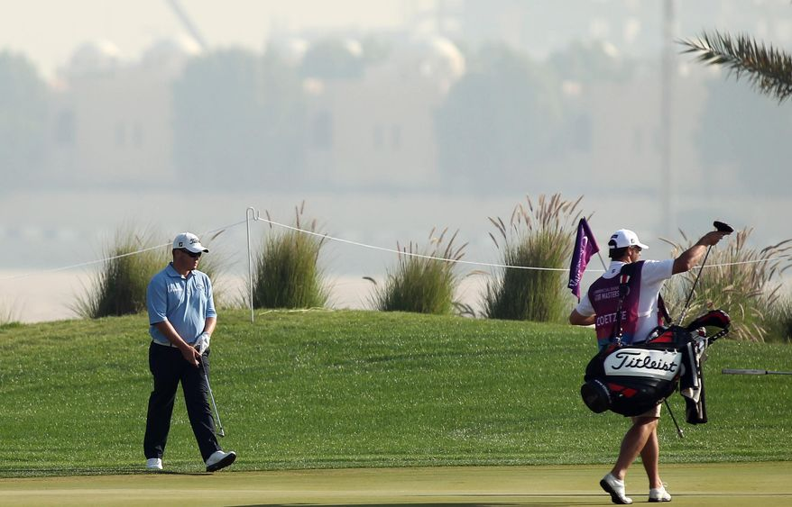 George Coetzee of South Africa during the second round of the Commercial Bank Qatar Masters at the Doha Golf Club in Doha, Qatar, Thursday, Jan. 23, 2014. (AP Photo/Osama Faisal)