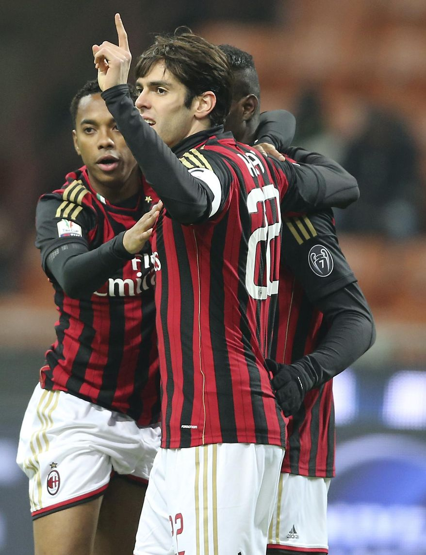 AC Milan forward Mario Balotelli, right, celebrates with his teammates Brazilian forwards Kaka, center, and Robinho after scoring during the Italian Cup soccer match between AC Milan and Udinese at the San Siro stadium in Milan, Italy, Wednesday, Jan. 22, 2014. (AP Photo/Antonio Calanni)