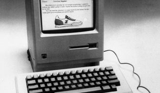 FILE -This Jan. 23, 1984, file photo, shows the Apple Macintosh that was unveiled in Cupertino, Calif..  The main console contains a 32 bit microprocessor, a built-in 3 1/2 inch disk drive, a nine inch display, 64k ROM and 128k RAM. (AP Photo/File)