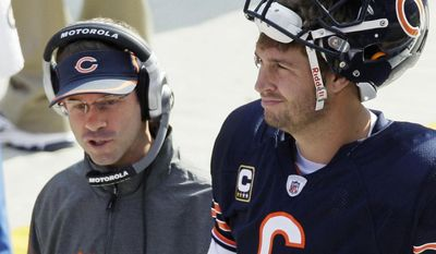 FILE - In this Oct. 24, 2010 file photo, Chicago Bears quarterbacks coach Shane Day, left, talks to starting quarterback Jay Cutler during an NFL football game against Washington Redskins in Chicago. (AP Photo/Charles Rex Arbogast, File)