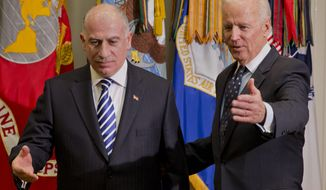 **FILE** Vice President Joe Biden and Iraqi Council of Representatives Speaker Osama al-Nujaifi gesture toward their seats at the start of their meeting in the Roosevelt Room of the White House in Washington on Jan. 22, 2014. (Associated Press)