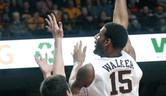 Minnesota's Maurice Walker shoots a hook shot in the second half of an NCAA college basketball game against Wisconsin, Wednesday, Jan. 22, 2014, in Minneapolis. Walker and DeAndre Mathieu each scored 18 points to lead Minnesota in their 81-68 win. (AP Photo/Jim Mone)