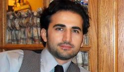 """FILE - This undated file photo released by his family via FreeAmir.org shows Amir Hekmati. Hekmati, a former U.S. Marine being held in Iran over the past two years on accusations of spying for the CIA. An interim nuclear agreement between world powers and Iran presents """"the perfect time"""" to press for the release of Hekmati being held on spying charges, a former defense secretary and three retired high-ranking generals wrote to President Barack Obama. The letter, dated Monday, Jan. 20, 2014 calls on the White House to take """"immediate action to facilitate the release"""" of Hekmati. (AP Photo/Hekmati family via FreeAmir.org, File)"""