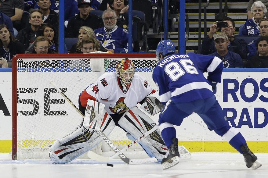 Tampa Bay Lightning right wing Nikita Kucherov (86), of Russia, prepares to score on Ottawa Senators goalie Craig Anderson (41) during a shootout in an NHL hockey game Thursday, Jan. 23, 2014, in Tampa, Fla. The Lightning won the game 4-3. (AP Photo/Chris O'Meara)