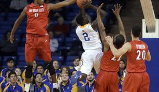 San Diego State's Skylar Spencer (0) blocks the shot of San Jose State's Jaleel Williams (2) during the first half of an NCAA college basketball game Wednesday, Jan. 22, 2014, in San Jose, Calif. (AP Photo/Ben Margot)