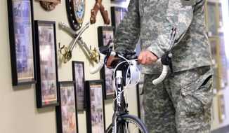 FOR USE MONDAY, JAN. 28 AND THEREAFTER - In this Jan. 14, 2014 photo, Sgt. Maj. Jerry W. Hochstedler poses with his bicycle at Fort Bliss, Texas. Hochstedler has always been an avid bicyclist, but he has rededicated himself to the sport since getting wounded. He cycles at least 250 miles a week and hopes one day to qualify for the Paralympics, an Olympic games for athletes with disabilities. (AP Photo/The El Paso Times, Mark Lambie)  EL DIARIO OUT; JUAREZ MEXICO OUT; IF USE ON LAM OR LAT AND EL DIARIO DE EL PASO OUT