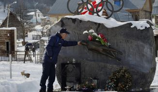 FOR STORY GEORGIA LUGER - In this photo taken Friday, Jan. 17, 2014 David Kumaritashvili, father of the Georgian luger Nodar Kumaritashvili killed during a training run at the 2010 Vancouver Olympics, stands at the grave of his son in Bakuriani, Georgia.  David Kumaritashvili laments that his country will have no one competing in the luge event when the games get under way next month in nearby Sochi. His son, Nodar Kumaritashvili, died when he lost control of his sled at nearly 145 kph (90 mph), flew off course and slammed into a steel pole. He was 21 and preparing to compete in his first Olympics halfway around the world in Vancouver, Canada. (AP Photo/Shakh Aivazov)