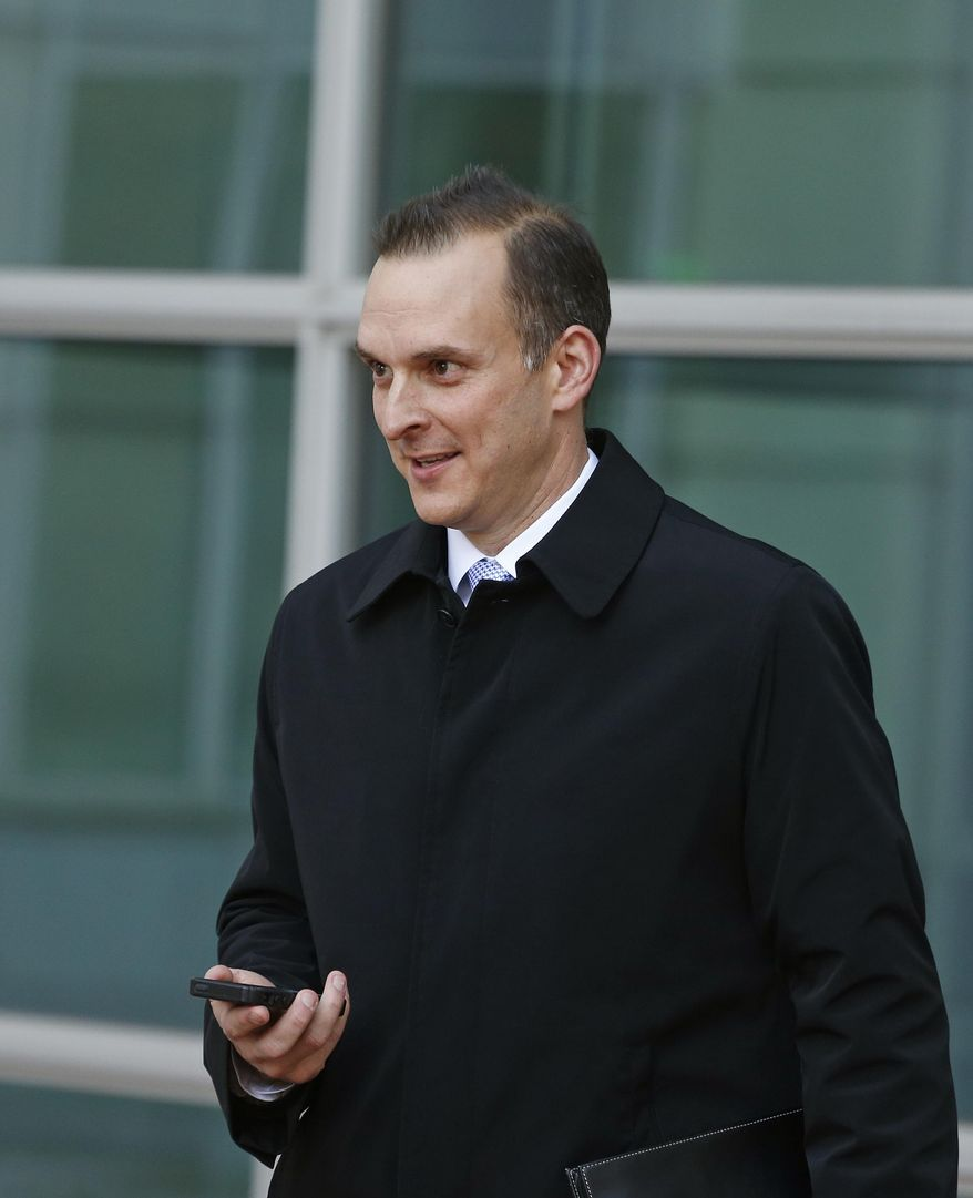 U.S. Anti-Doping Agency (USADA) CEO Travis Tygart leaves a federal courthouse following the sentencing of a man who sent Tygart a threatening email, in Denver, Thursday Jan. 23, 2014. A judged on Thursday ordered Gerrit Keats, of Clearwater, Fla., to serve three years' probation and complete 540 hours of community service for threatening Tygart after the USADA stripped Lance Armstrong of his Tour de France titles. (AP Photo/Brennan Linsley)