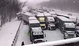 This cell phone image shows a massive highway pileup on Interstate 94 near Michigan City, Ind., Thursday, Jan. 23, 2014, that is being blamed on whiteout conditions. The accident has left at least two people dead and an unknown number injured in northwestern Indiana.  Indiana State Police say they have closed Interstate 94 eastbound and are bringing in cranes and wreckers to help clear the scene. (AP Photo/Sun-Times Media, Matt Carpenter)