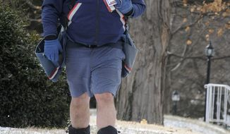 On a day with single digit temperatures and a National Weather Service wind chill advisory, Henderson, Ky mail carrier Kevin Wilke prefers to make his rounds Thursday Jan. 23, 2014,  in shorts. He wears a coat, ear muffs, gloves and boots but says he is more comfortable in shorts. (AP Photo/The Gleaner, Mike Lawrence)