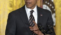 President Barack Obama gestures as he speaks during an reception for the U.S. Conference of Mayors in the East Room of the White House, Thursday, Jan. 23, 2014, in Washington. (AP Photo/Carolyn Kaster)