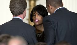Housing and Urban Development Secretary Shaun Donovan, left, and Transportation Secretary Anthony Foxx, right, talk with Baltimore Mayor Stephanie Rawlings-Blake, center before President Barack Obama speaks at a reception for the U.S. Conference of Mayors in the East Room of the White House, Thursday, Jan. 23, 2014, in Washington. (AP Photo/Carolyn Kaster)