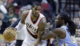 Portland Trail Blazers forward LaMarcus Aldridge, left, works the ball against Denver Nuggets forward Kenneth Faried during the first half of an NBA basketball game in Portland, Ore., Thursday, Jan. 23, 2014. (AP Photo/Don Ryan)