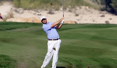 Thomas Aiken of South Africa follows his shot on the 16th hole during the third round of the Commercial Bank Qatar Masters at the Doha Golf Club in Doha, Qatar, Friday, Jan. 24, 2014. (AP Photo/Osama Faisal)