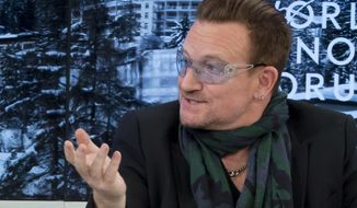 """Rock star Bono speaks during a panel discussion """"The Post-2015 Goals: Inspiring a New Generation to Act,"""" the fifth annual Associated Press debate, at the World Economic Forum in Davos, Switzerland, Friday, Jan. 24, 2014. (AP Photo/Michel Euler) ** FILE **"""