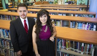 Carlos Perrett, 18, and Janet Nieto, 18, both senior students at Cesar E. Chavez High School have been admitted to top universities with full scholarships through the support of the EMERGE Fellowship and their own hard work. Both students are the first generation in their families to go to college. Thursday, Jan. 16, 2014, in Houston. (AP Photo/Houston Chronicle, Marie D. De Jesus)