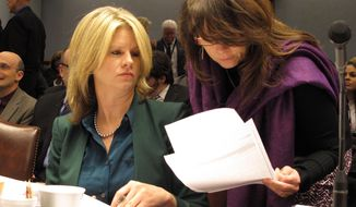 Commissioner of Administration Kristy Nichols, the governor's chief budget adviser, left, reviews budget information with lawyer Liz Murrill on Friday, Jan. 24, 2014, in Baton Rouge, La. Nichols presented Gov. Bobby Jindal's budget recommendations for the upcoming fiscal year. (AP Photo/Melinda Deslatte)