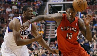 Toronto Raptors' Amir Johnson, right, loses the ball while trying to drive past Philadelphia 76ers' Thaddeus Young during the first half of an NBA basketball game, Friday, Jan. 24, 2014, in Philadelphia. (AP Photo/Matt Slocum)