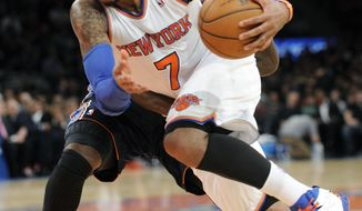 New York Knicks' Carmelo Anthony (7) drives by Charlotte Bobcats' Michael Kidd-Gilchrist during the second quarter of an NBA basketball game, Friday, Jan. 24, 2014, at Madison Square Garden in New York. Anthony scored 62 points as the Knicks defeated the Bobcats 125-96.  (AP Photo/Bill Kostroun)