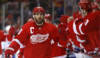 Detroit Red Wings left wing Henrik Zetterberg (40), of Sweden, celebrates his goal against the Montreal Canadiens in the first period of an NHL hockey game, Friday, Jan. 24, 2014, in Detroit. (AP Photo/Paul Sancya)