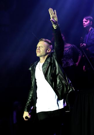 Musician Macklemore performs during a concert presented by T-Mobile at The Belasco Theatre, Thursday,