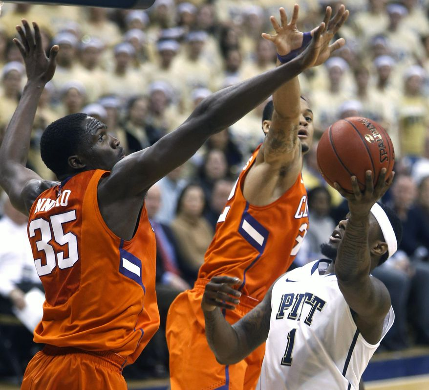 Pittsburgh's Jamel Artis (1) gets a shot around Clemson's Landry Nnoko (35) and K.J. McDaniels as they defend during the first half of an NCAA college basketball game on Tuesday, Jan. 21, 2014, in Pittsburgh. (AP Photo/Keith Srakocic)