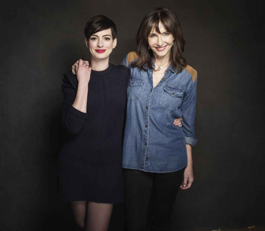 "In this Tuesday, Jan. 21, 2014 photo, cast members Anne Hathaway and Mary Steenburgen pose for a portrait at The Collective and Gibson Lounge Powered by CEG, during the Sundance Film Festival, in Park City, Utah. The actresses starred in the film, ""Song One,"" directed by Kate Barker-Froyland, which premiered at the 2014 Sundance Film Festival. (Photo by Victoria Will/Invision/AP)"