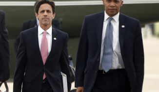 In this Oct. 30, 2013, photo, David Simas, Deputy Senior Adviser for Communications and Strategy, left, and Rob Nabors, Deputy Chief of Staff accompany President Barack Obama to board Air Force One at Andrews Air Force Base, Md., as he travels to Boston to speak about the federal health care law. Obama is bringing back an internal White House political office as this year's congressional election approaches. Obama announced Jan. 24, 2014, that he's named Simas, a top adviser grappling with problems with his health care rollout, to oversee a new Office of Political Strategy and Outreach.(AP Photo/Charles Dharapak)
