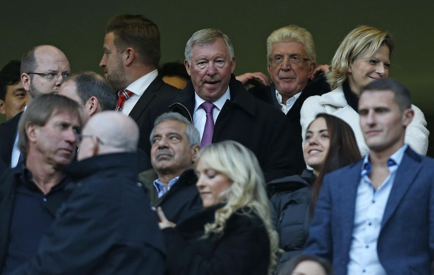 Former Manchester United manager Sir Alex Ferguson, top centre, takes his place in the stands before Chelsea play Manchester United in a English Premier League soccer match at Stamford Bridge, London, Sunday, Jan. 19, 2014. (AP Photo/Sang Tan)
