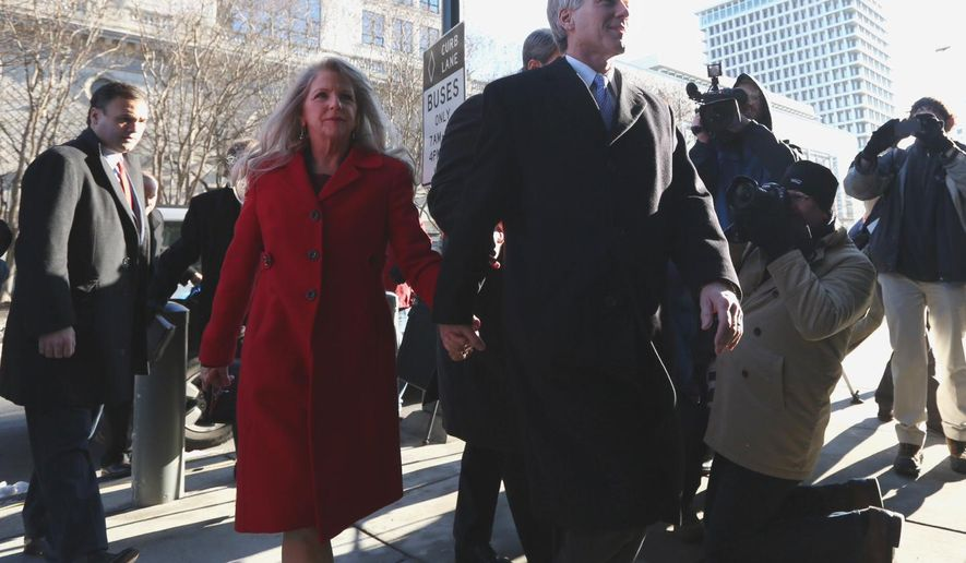 Former Virginia Gov. Bob McDonnell and his wife Maureen arrive at the U.S. District Court in Richmond on Friday, Jan. 24, 2014, for his and his wife Maureen's bond hearing and arraignment on Friday, Jan. 24, 2014 on federal corruption charges. Federal prosecutors allege that the McDonnells accepted more than $165,000 worth of loans and gifts from Jonnie Williams, the former head of Star Scientific Inc.  (AP Photo/The Virginian-Pilot, Steve Earley)  MAGS OUT