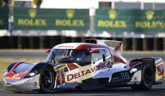 Katherine Legge, of England, drives the DeltaWing DWC13 during qualifying for the IMSA Series Rolex 24 hour auto race at Daytona International Speedway in Daytona Beach, Fla., Thursday, Jan. 23, 2014. Legge qualified in the eighth position for the race. (AP Photo/John Raoux)