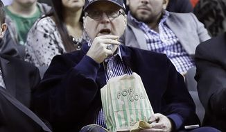 Portland Trail Blazers owner Paul Allen watches from his seat under the basket during the second half of an NBA basketball game against the Denver Nuggets in Portland, Ore., Thursday, Jan. 23, 2014.  Portland Won 110-105. (AP Photo/Don Ryan)