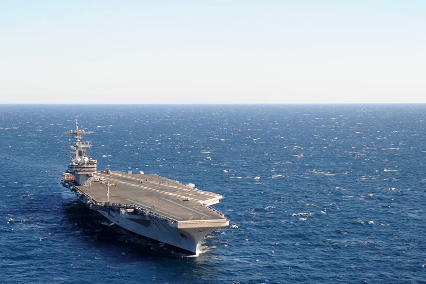 ** FILE ** The USS George H.W. Bush aircraft carrier was commissioned on January 10, 2009. (U.S. Navy)