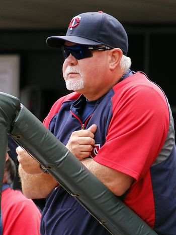 FILE - In this Aug. 4, 2013 file photo, Minnesota Twins manager Ron Gardenhire watches from the dugout during the first inning of a baseball gameagainst the Houston Astros  in Minneapolis. Plenty of people expected 2013 to be Gardenhire's last in Minnesota. Truth be told, Gardenhire might have been one of them. But the Twins brought back their longtime manager for two more years, and he's ready to set things right after three straight miserab