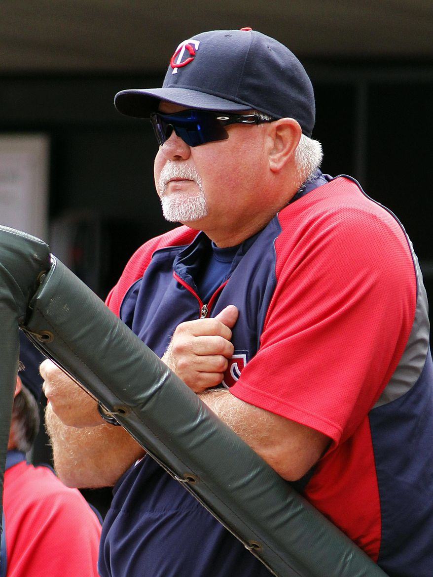 FILE - In this Aug. 4, 2013 file photo, Minnesota Twins manager Ron Gardenhire watches from the dugout during the first inning of a baseball gameagainst the Houston Astros  in Minneapolis. Plenty of people expected 2013 to be Gardenhire's last in Minnesota. Truth be told, Gardenhire might have been one of them. But the Twins brought back their longtime manager for two more years, and he's ready to set things right after three straight miserable seasons.  (AP Photo/Andy Clayton-King, File)