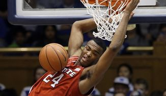 North Carolina State's T.J. Warren (24) dunks against Duke during the second half of an NCAA college basketball game in Durham, N.C., Saturday, Jan. 18, 2014. Duke won 95-60. (AP Photo/Gerry Broome)