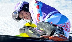 ADVANCE FOR WEEKEND EDITIONS, JAN. 25-26  - In this Dec. 17, 2013, file photo, France's Tessa Worley grimaces after crashing during her first run in a women's World Cup slalom ski race in Courchevel, France. Along with American Lindsey Vonn, Worley will be the sidelined for the Sochi Olympics because of a knee injury. (AP Photo/Marco Tacca, File)