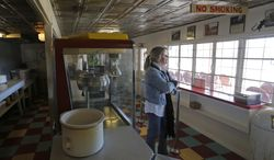 Brazos Drive-in Theater owner Jennifer Miller stands in the concession stand. She has decided to sell the theater in Granbury because of the cost of converting to digital projection from 35mm film, Tuesday, Jan. 14, 2014. (AP Photo/Star-Telegram, Rodger Mallison)