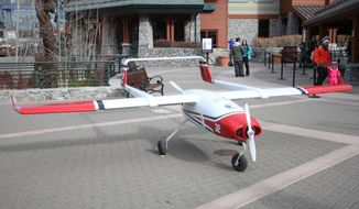 ** FILE ** This Jan. 9, 2014, photo shows the Desert Research Institute's new cloud seeding drone at Heavenly Village in South Lake Tahoe, Calif. The drone has the ability to release silver iodide into a storm and generate additional rain or snowfall. (AP Photo/The Tahoe Tribune, Griffin Rogers)