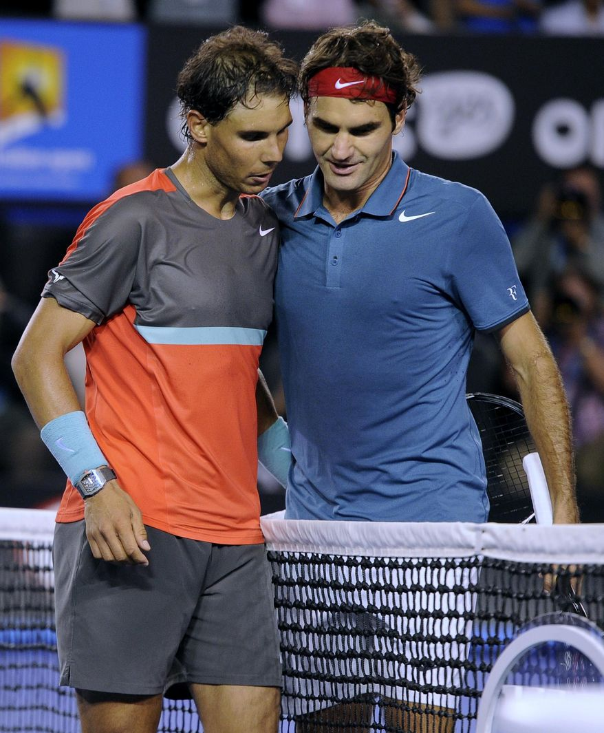 Rafael Nadal of Spain, left, is congratulated by Roger Federer of  Switzerland at the net after Nadal won their semifinal final at the Australian Open tennis championship in Melbourne, Australia, Friday, Jan. 24, 2014.(AP Photo/Andrew Brownbill)