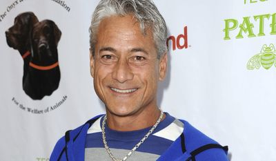 "FILE - In this April 13, 2013 file photo, former Olympic diving champion Greg Louganis arrives at the ""Saving Tails"" event honoring songwriter Diane Warren in Los Angeles. Louganis will be part of the broadcast crew covering the Westminster dog show events in February 2014, and will work for Fox Sports 1 at the agility competition on Feb. 8. (Photo by Richard Shotwell/Invision/AP, File)"