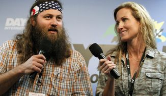 "** FILE ** This Feb. 24, 2013, file photo shows Willie Robertson, left, and Korie Robertson, of the reality TV show, ""Duck Dynasty,"" before the Daytona 500 NASCAR Sprint Cup Series auto race, at Daytona International Speedway in Daytona Beach, Fla. (AP Photo/Terry Renna, File)"