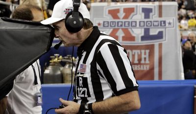 "ADVANCE FOR WEEKEND EDITIONS, JAN. 25-26 - In this Feb. 5, 2006, file photo, feferee Bill Leavy reviews the play after Pittsburgh Steelers quarterback Ben Roethlisberger's 1-yard dive was called a touchdown during the second quarter of play against the Seattle Seahawks at the Super Bowl XL football game in Detroit. The call stood as a touchdown.  Seattle's basketball team now plays in Oklahoma. The once proud baseball franchise hasn't been to the playoffs in more than a decade. And don't even mention the Super Bowl loss to Pittsburgh. The name ""Bill Leavy"" might as well be an expletive in these parts.  (AP Photo/Paul Sancya, File)"