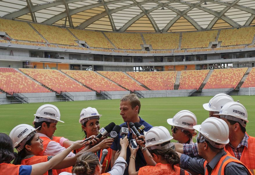Head coach of the United States soccer team, Jurgen Klinsmann, from Germany, talks with the press inside Arena da Amazonia stadium in Manaus, Brazil, Friday, Jan. 24, 2014. Manaus is one of the host cities for the 2014 World Cup, and will host a game between the U.S. and Portugal. (AP Photo/Raphael Alves)