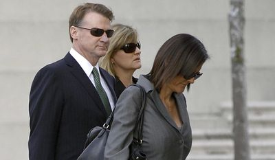 FILE - This Jan. 21, 2014 file photo shows former Deutsche Bank executive Brian Mulligan, left, arriving with his wife Victoria, center, at the Edward R. Roybal Federal Building, in Los Angeles. Mulligan lost his $20 million excessive force lawsuit against the Los Angeles Police Department, according to a report Friday Jan. 24, 2014. The woman at right is unidentified.   (AP Photo/Damian Dovarganes, file)