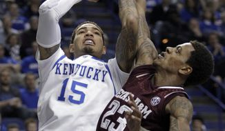 Kentucky's Willie Cauley-Stein (15) shoots under pressure from Texas A&M's Kyle Dobbins during the first half of an NCAA college basketball game, Tuesday, Jan. 21, 2014, in Lexington, Ky. (AP Photo/James Crisp)